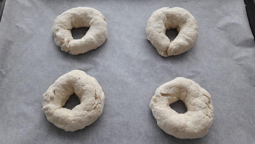 Transfer bagels to prepared baking sheet