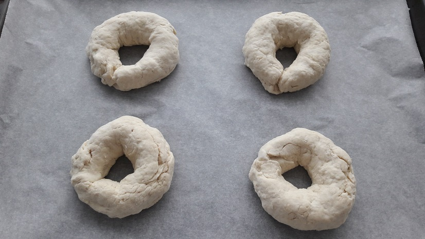 Transfer bagels to prepared baking sheet